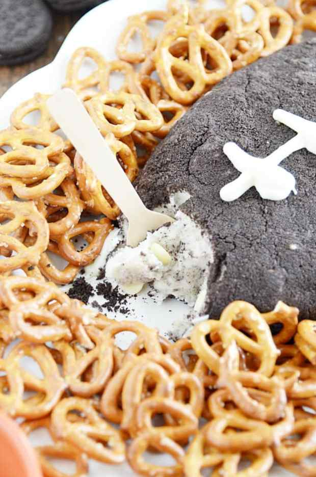 A sweet Cookies & Cream Cheeseball that looks like a football. The perfect dip recipe for your Super Bowl party!