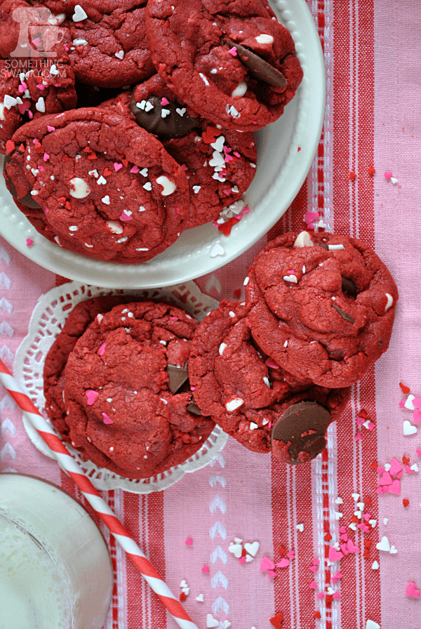 These Red Velvet Funfetti Cookies will ROCK. YOUR. WORLD. I seriously can't stop gushing over how thick and chewy they are, plus they pack a serious chocolately chip punch! #redvelvet #cookies #valentines