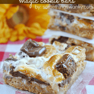 Nutter Butter S'mores Magic Bars on www.somethingswanky.com #recipes #dessert