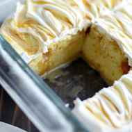 Yellow cake soaked in cheesecake pudding and salted caramel, topped with Cool Whip and a salted caramel swirl.