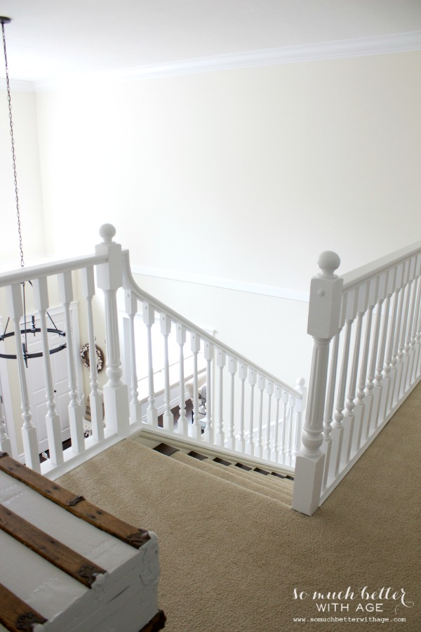 White staircase / Neutral foyer via somuchbetterwithage.com