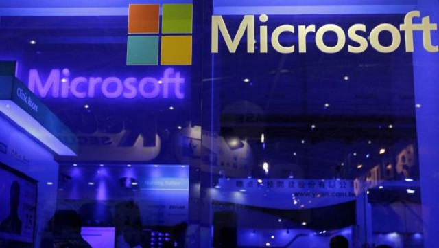 People visit Microsoft booth at the 2013 Computex exhibition at the TWTC Nangang exhibition hall in Taipei in this file photo