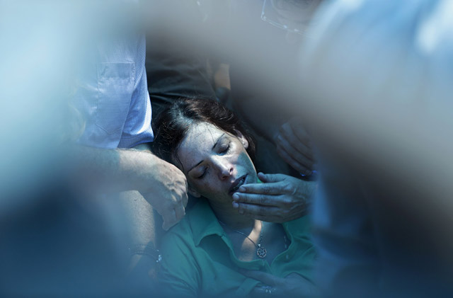 Dana, the sister of Israeli soldier Tsafrir Bar-Or, mourns during his funeral in Holon near Tel Aviv