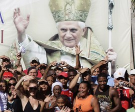 People wait for Pope Benedict XVI to pass by in Cuba