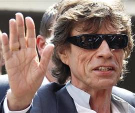 Rolling Stones lead singer Jagger arrives at a photocall to promote the film Stones In Exile at the 63rd Cannes Film Festival