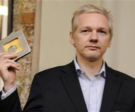 WikiLeaks founder  Assange holds up CD's with data on offshore bank account holders