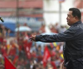 Venezuela's President and presidential candidate Chavez throws his microphone after speaking during his closing campaign rally in Caracas