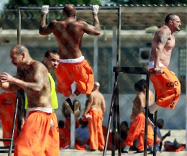 Inmates exercise at the California Institution for Men state prison in Chino