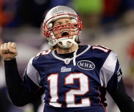 New England Patriots quarterback Tom Brady (12) celebrates after scoring a one yard touchdown during the second half of the AFC Championship NFL football game against the Baltimore Ravens Sunday, Jan. 22, 2012, in Foxborough, Mass.  (AP Photo/Stephan Savoia)
