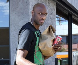 Lamar Odom steps the day after DUI arrest to get take out from 'Vegan Cuisine' in Studio City, CA. The troubled NBA star was wearing a Public Enemy T shirt which may be a metaphor for how he feels he's been portrayed in the media.   Pictured: Lamar Odom  Ref: SPL602886  310813   Picture by: Splash News  Splash News and Pictures Los Angeles: 310-821-2666 New York: 212-619-2666 London: 870-934-2666 photodesk@splashnews.com