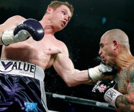 Miguel Cotto, right, of Puerto Rico, get hits by Canelo Alvarez, of Mexico, during a WBC middleweight title bout Saturday, Nov. 21, 2015, in Las Vegas. (AP Photo/John Locher)