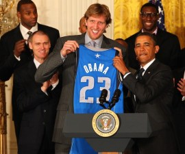 WASHINGTON, DC - JANUARY 9: President Barack Obama receives a personalized jersey from Dirk Nowitzki #41 during a visit by the Dallas Mavericks to the White House to commemorate the 2011 NBA Champions on January 9, 2012 in Washington, DC. NOTE TO USER: User expressly acknowledges and agrees that, by downloading and or using this photograph, User is consenting to the terms and conditions of the Getty Images License Agreement. Mandatory Copyright Notice: Copyright 2012 NBAE (Photo by Ned Dishman/NBAE via Getty Images)