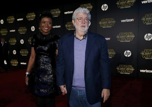 "Star Wars creator George Lucas and wife, Mellody Hobson, arrive at the premiere of ""Star Wars: The Force Awakens"" in Hollywood, California December 14, 2015. REUTERS/Mario Anzuoni"