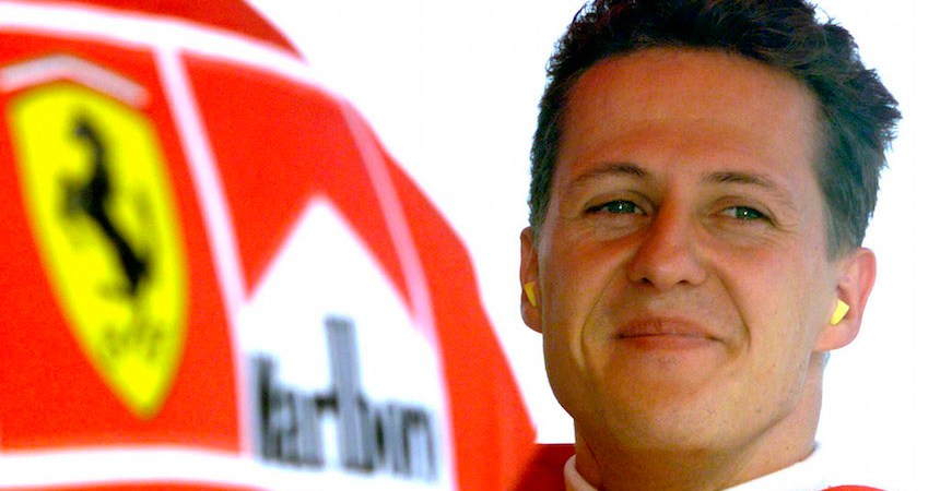 Germany's Michael Schumacher smiles in the pit area after completing his second qualifying session of the Hungarian Formula One Grand Prix in this August 15, 1998 file photo. Ferrari fans held a vigil for Michael Schumacher on his 45th birthday on January 3, 2014, gathering outside the French hospital where the seven times world champion continued to fight for his life after a skiing accident. Schumacher's family thanked the fans in a statement on Friday evening saying they were moved to tears while French media reported that investigators were studying a camera the German had on him at the time of the accident.  REUTERS/Radu Sigheti/Files (HUNGARY - Tags: SPORT MOTORSPORT F1)