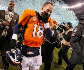 EAST RUTHERFORD, NJ - FEBRUARY 02:  Quarterback Peyton Manning #18 of the Denver Broncos reacts as he walks off the field after their 43-8 loss to the Seattle Seahawks during Super Bowl XLVIII at MetLife Stadium on February 2, 2014 in East Rutherford, New Jersey.  (Photo by Kevin C. Cox/Getty Images)