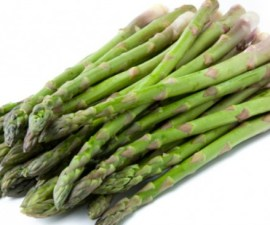 Green asparagus spears on white.
