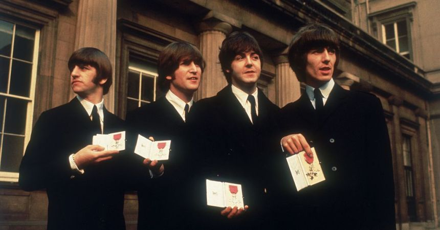 26th October 1965:  Liverpudlian pop group The Beatles with their MBEs at Buckingham Palace in London after their investiture ceremony.  (Photo by George Freston/Fox Photos/Getty Images)