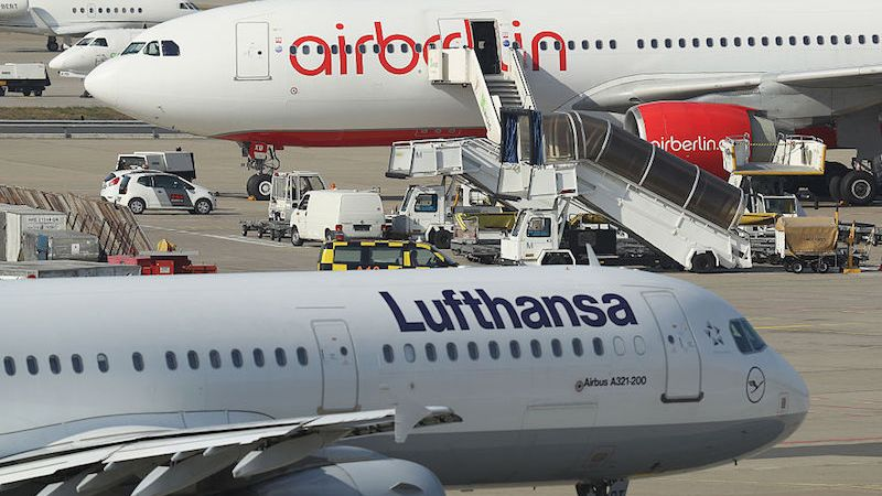 BERLIN, GERMANY - SEPTEMBER 26:  A passenger plane of German airliner Lufthansa passes by one of Air Berlin on the tarmac at Tegel Airport on September 26, 2016 in Berlin, Germany. According to media reports Air Berlin, which has struggled financially for years, is planning on cutting 1,000 out of 8,600 jobs and leasing 40 of its planes to rival Germanwings, the discount airliner operated by Lufthansa.  (Photo by Sean Gallup/Getty Images)