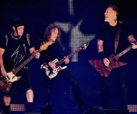 "SAN FRANCISCO, CA - FEBRUARY 06:  (L-R) Musicians Robert Trujillo, Kirk Hammett and James Hetfield of Metallica perform onstage at CBS RADIO's third annual ""The Night Before"" at AT&T Park on February 6, 2016 in San Francisco, California.  (Photo by Kevin Winter/Getty Images for CBS)"