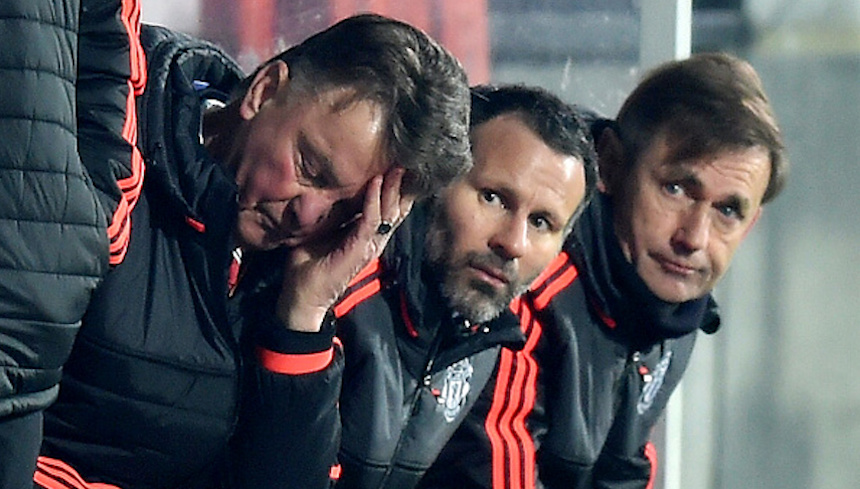 HERNING, DENMARK - FEBRUARY 18:  Louis van Gaal (L) Manager of Manchester United scratches his head while Ryan Giggs (C) assistant manager looks on during the UEFA Europa League round of 32 first leg match between FC Midtjylland and Manchester United at Herning MCH Multi Arena on February 18, 2016 in Herning, Denmark.  (Photo by Michael Regan/Getty Images)