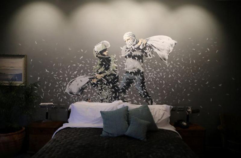 Obra de Banksy en palestina