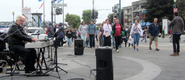 Chuck Girard sings at Fisherman's Wharf during SOS.