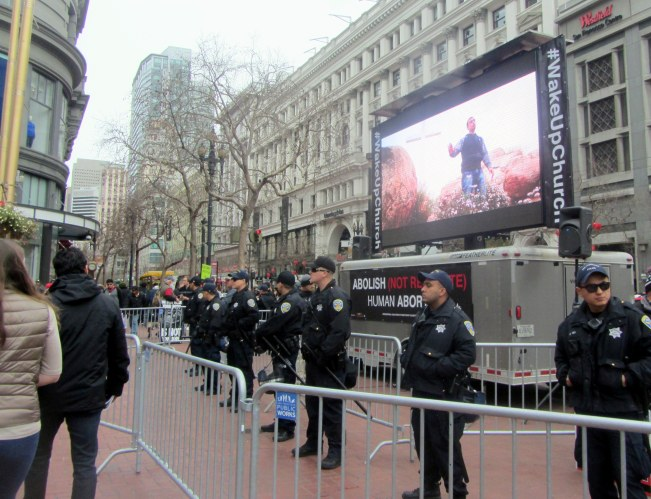Anti-abortion group shows film on giant screen at Powell and Market during March for Life half a block from our outreach.