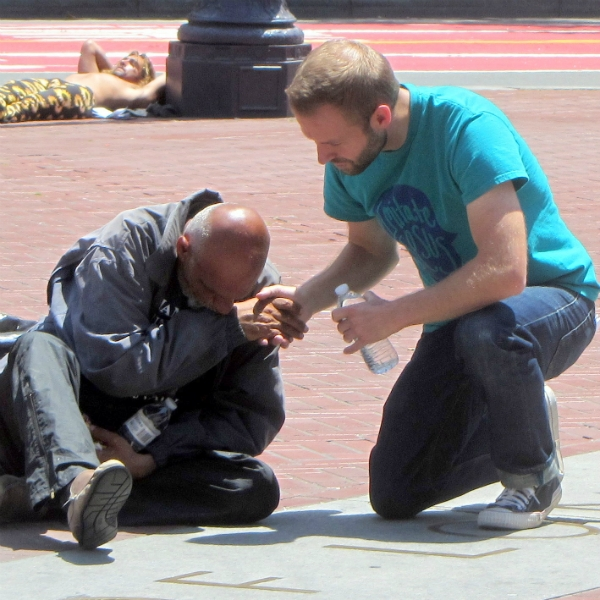 CAL PRAYS FOR MAN AT UN PLAZA.