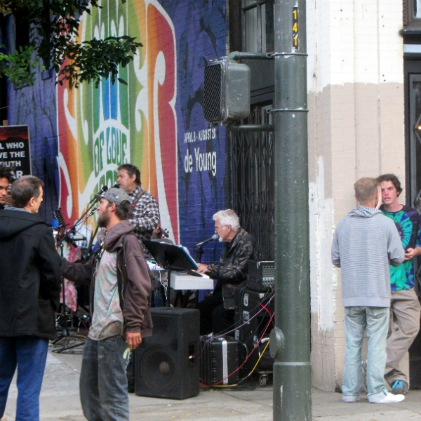 MIKE AND CAL WITNESS WHILE PAUL AND CHUCK SING ON HAIGHT ST.