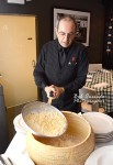 Pascuale pours the hot fettuccine into the ruota.