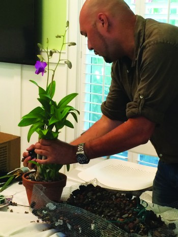 H2-Guillermo-Salazar-repotting-orchid-during-class