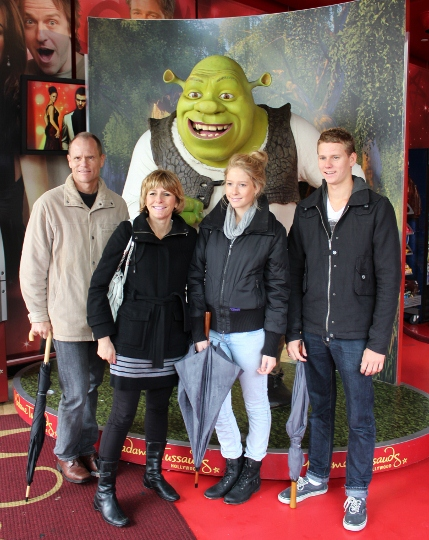 "My ""adoptive"" family poses with Shrek outside Madame Tussaud's Wax Museum."