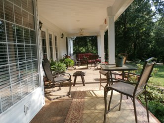 DIY porch makeover remodel with newly spray painted chairs.