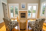Gather around the fireplace for engaging conversation or an evening glass of wine.