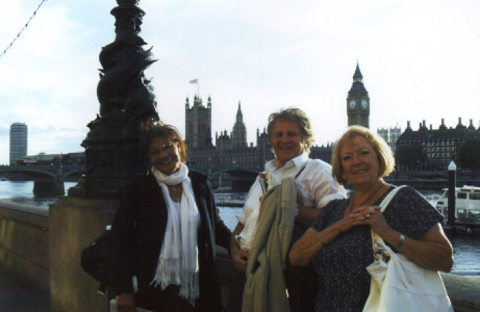 Explorerse posing with Westminister in the background