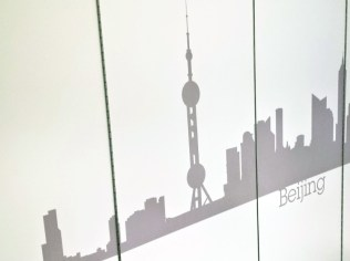 Image of Lane 4 retractable office divider wall with vinyl graphics