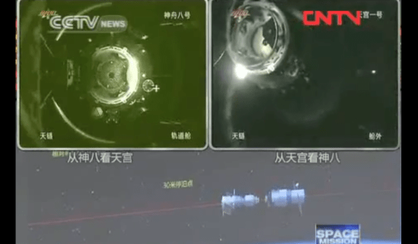 A stil frame of the Shenzou Tiangong docking (Source: CNTV).