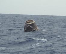 Dragon floating in the Pacific Ocean after a successful splash down (Credits: SpaceX).
