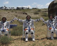 The Shenzhou 9 crew seated shortly after landing. The crew is no longer experiencing dizziness or the other sideeffects of microgravity (Credits: CCTV).