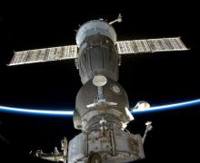 A Soyuz capsule docked at the International Space Station (Credits: Roscosmos).