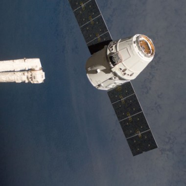 The SpaceX Dragon commercial cargo craft, as it is about to be grappled by the Canadarm2 robotic arm at the International Space Station in May 2012 (Credits: NASA).