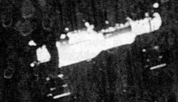Grainy image from the departing Soyuz 11 mission in June 1971, showing Salyut 1. This was one of the last close-up views of the world's first space station. Credits: Roscosmos.