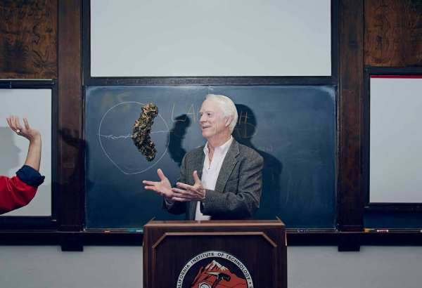 Astronaut Rusty Schweickart catches a model asteroid Itokawa