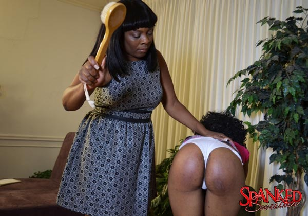 Lana paddles Cupcake's lovely brown bottom with a bath brush