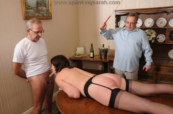 Spanking Sarah gets caned as she gives a blowjob