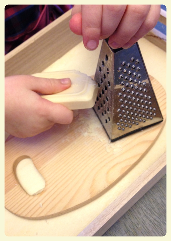 Grating soap Montessori learning tray for building fine motor skills. Featured by Special Learning House. www.speciallearninghouse.com