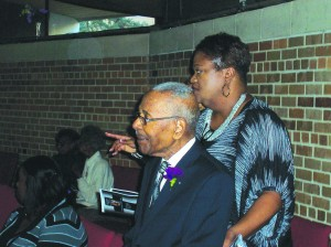 Reverend Smith with Brenda Johnson, a member of Wayman AME Church Photo by Jamal Denman