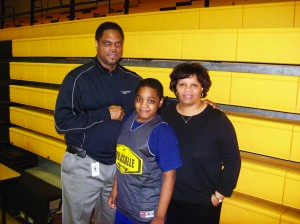 Faith Johnson-Patterson, right, with her husband and DeLaSalle Assistant Girls' Basketball Coach John Patterson and their son and student manager John Patterson, Jr.  Photo by Charles Hallman