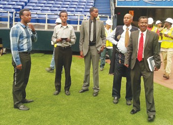 Abdizirak Bihi, at right in foreground with red tie, with others from the Somali Education and Social Advocacy Center and Summit OIC students in the background who hope to be included in the stadium construction project Photo by Avi Viswanathan