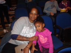 Lynx fan Tina Jones with goddaughter Makenzi Sims